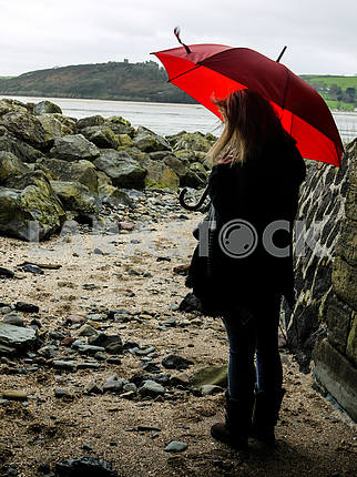Young Woman With a Red Umbrella