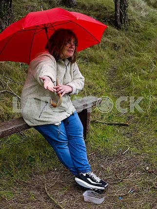 Woman Checking for Rain