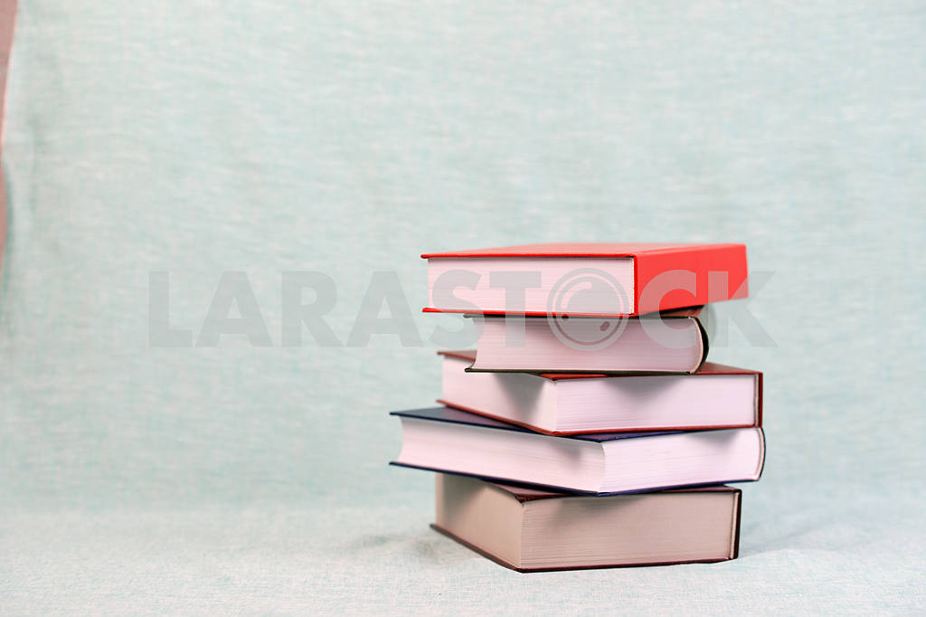 Stack of hardback books on wooden table. Back to school. — Image 47124