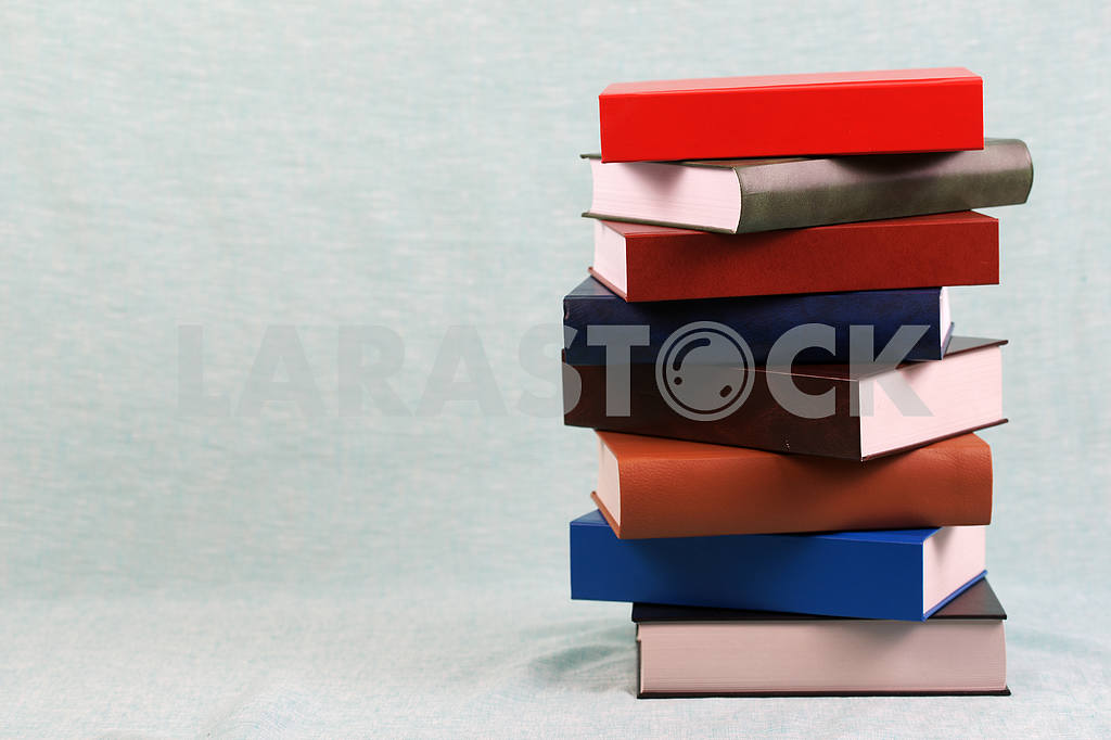 Stack of hardback books on wooden table. Back to school. — Image 47134