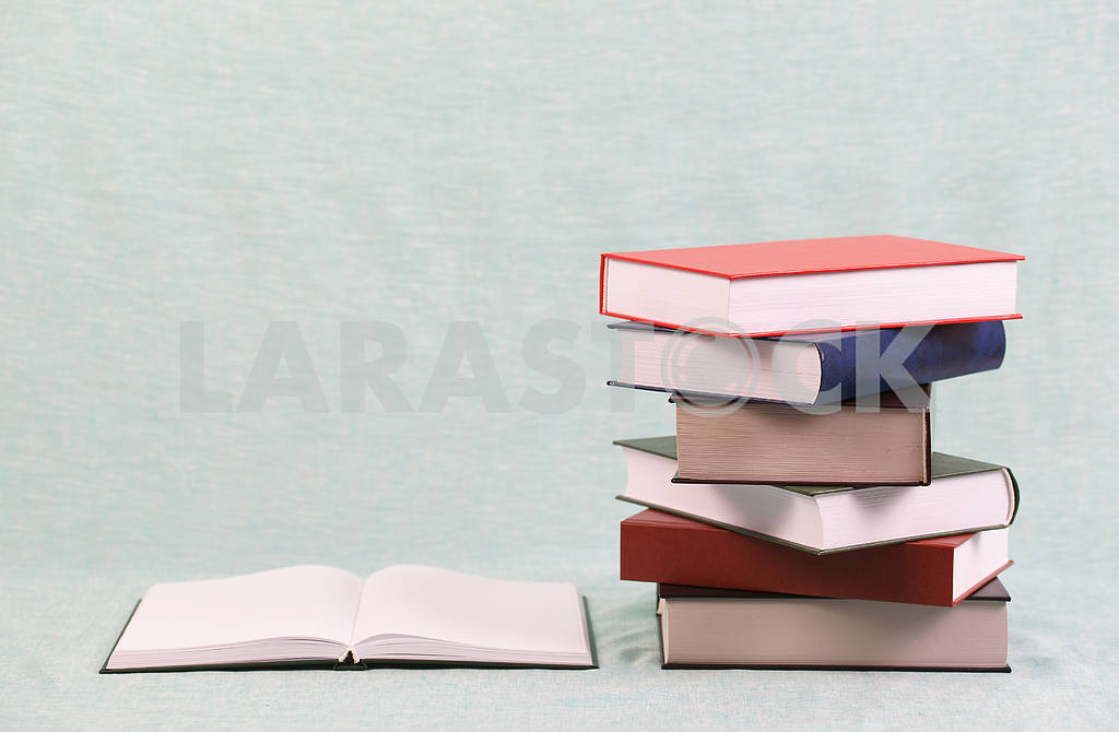 Stack of hardback books on wooden table. Back to school. — Image 47136