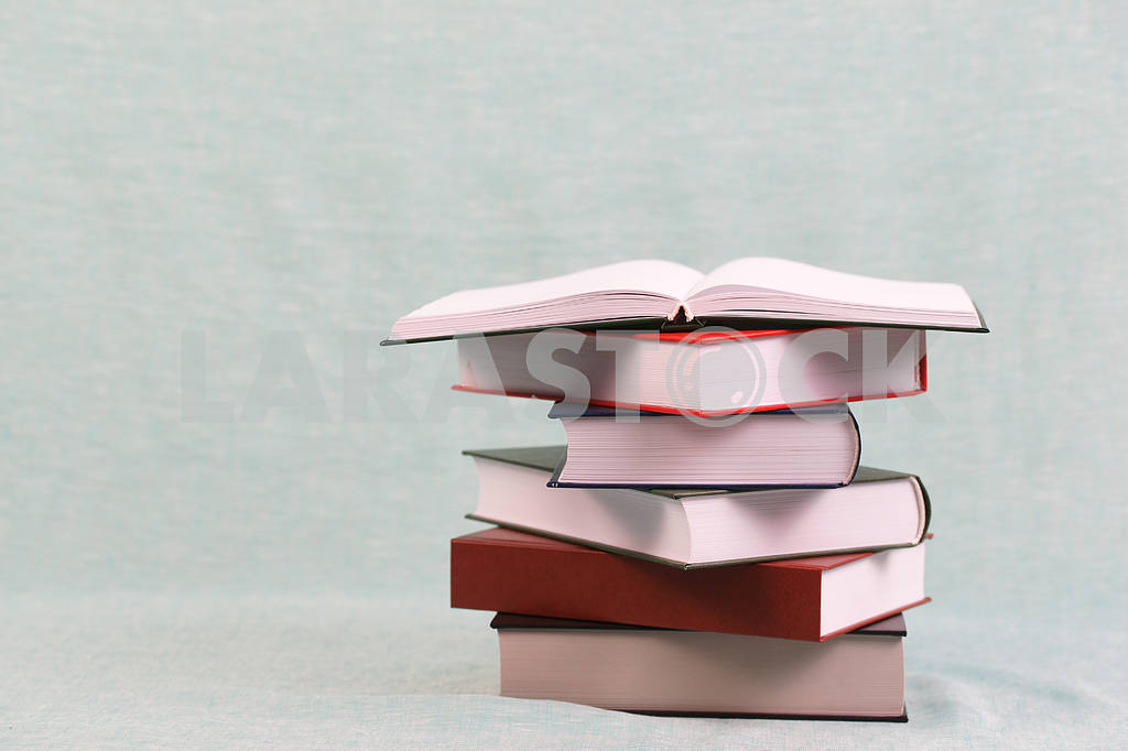 Stack of hardback books on wooden table. Back to school. — Image 47139