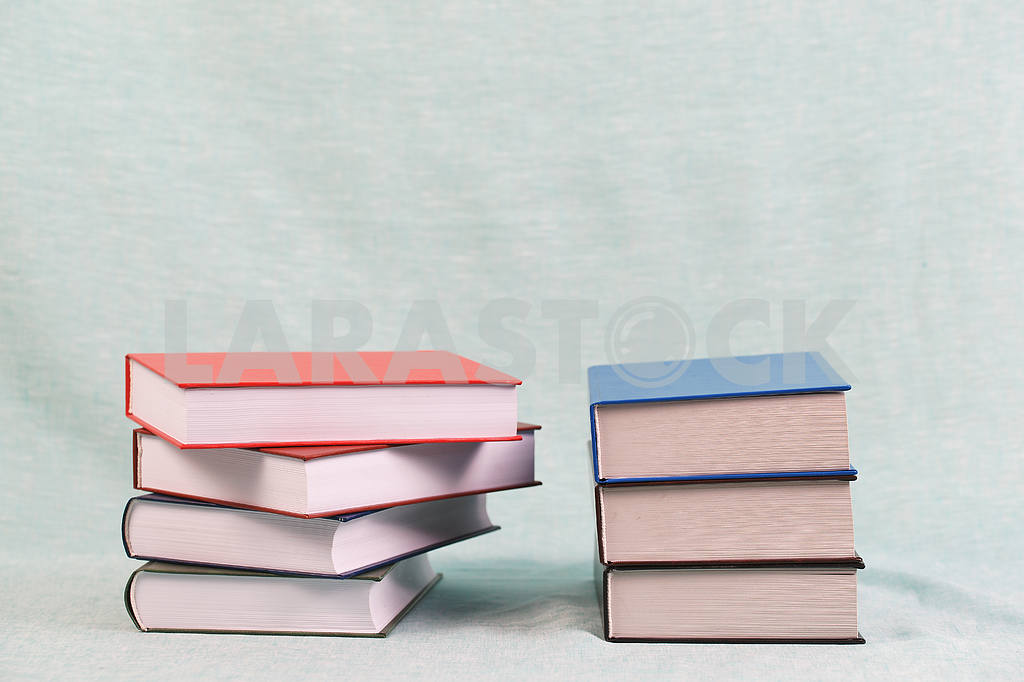 Stack of hardback books on wooden table. Back to school. — Image 47141