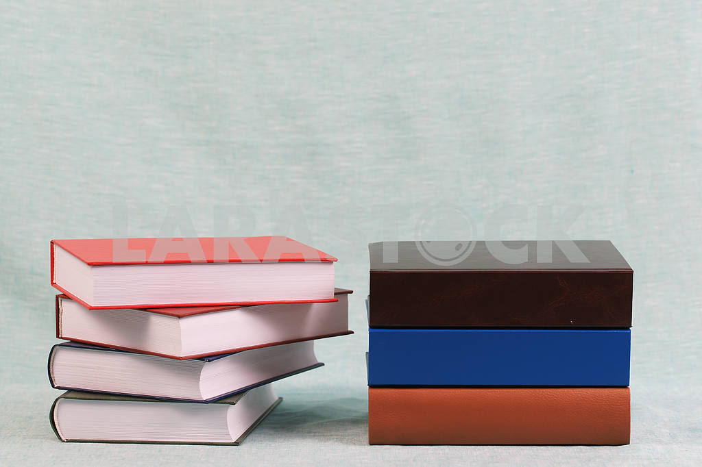 Stack of hardback books on wooden table. Back to school. — Image 47142