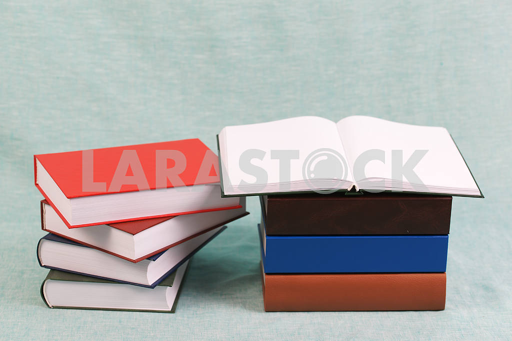 Stack of hardback books on wooden table. Back to school. — Image 47144