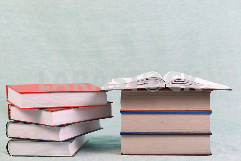 Stack of hardback books on wooden table. Back to school. — Image 47149