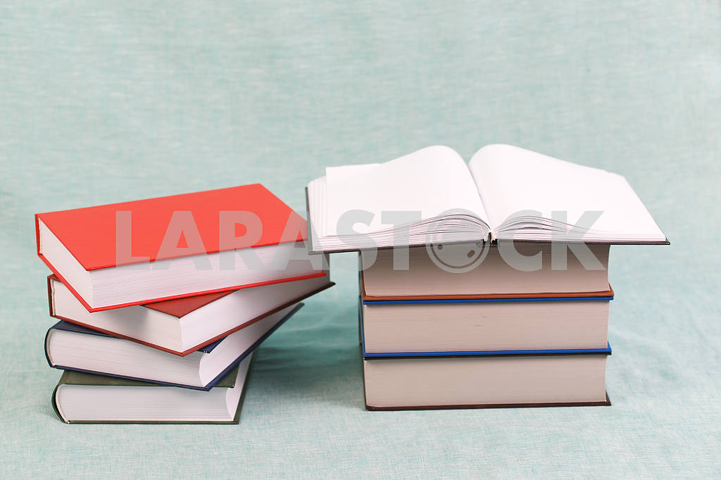 Stack of hardback books on wooden table. Back to school. — Image 47150