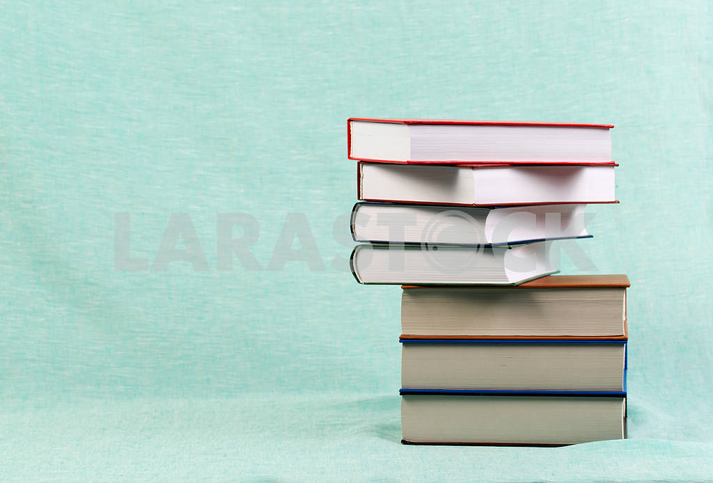 Stack of hardback books on wooden table. Back to school. — Image 47152