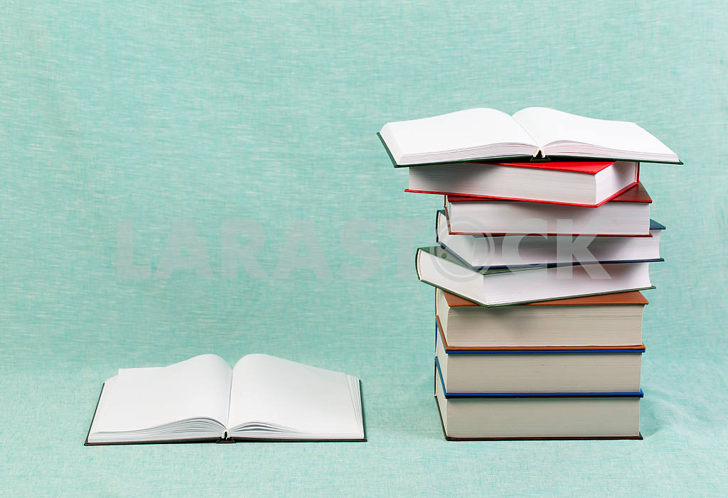 Stack of hardback books on wooden table. Back to school. — Image 47156