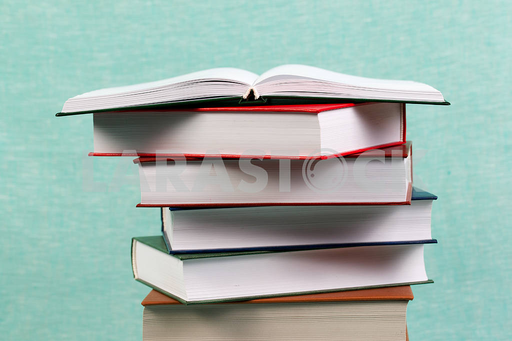 Stack of hardback books on wooden table. Back to school. — Image 47157