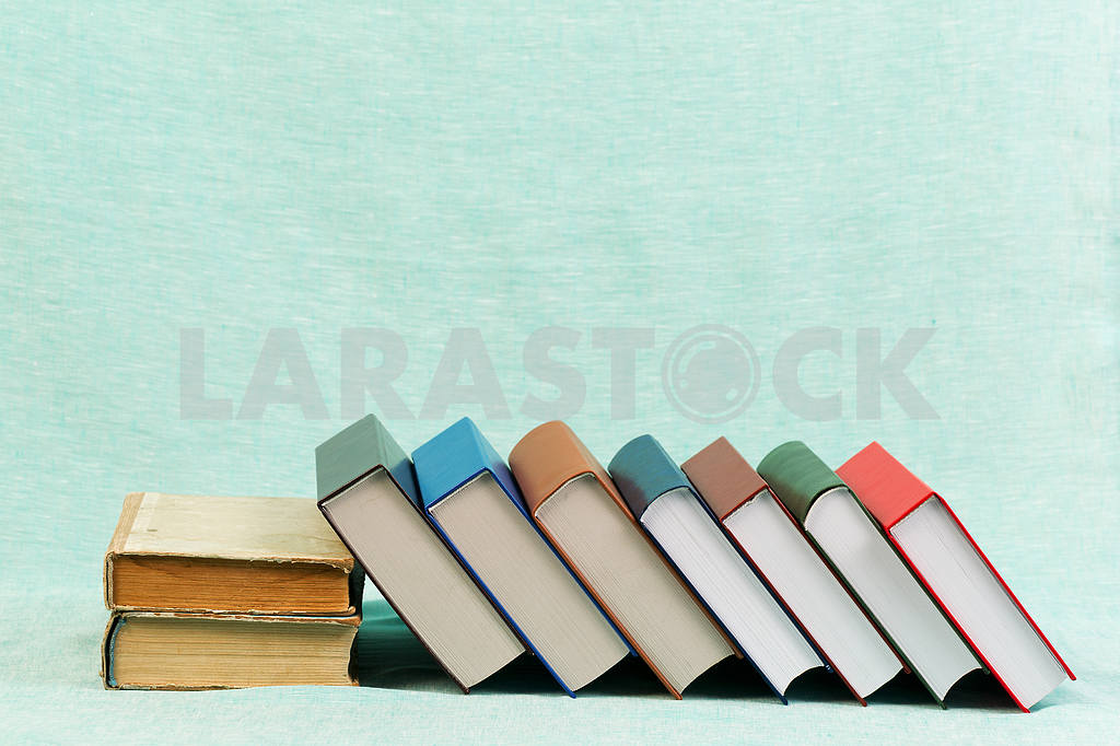 Stack of hardback books on wooden table. Back to school. — Image 47160