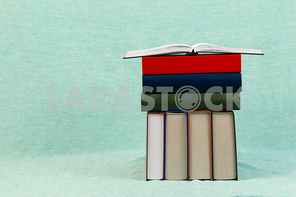 Stack of hardback books on wooden table. Back to school. — Image 47168
