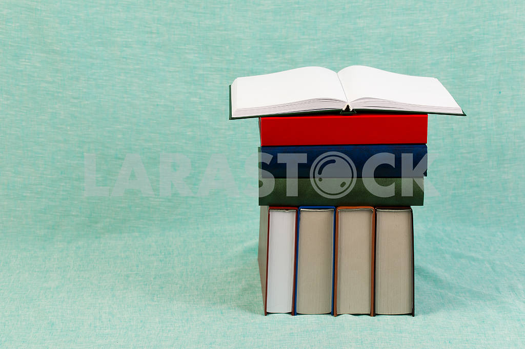 Stack of hardback books on wooden table. Back to school. — Image 47169