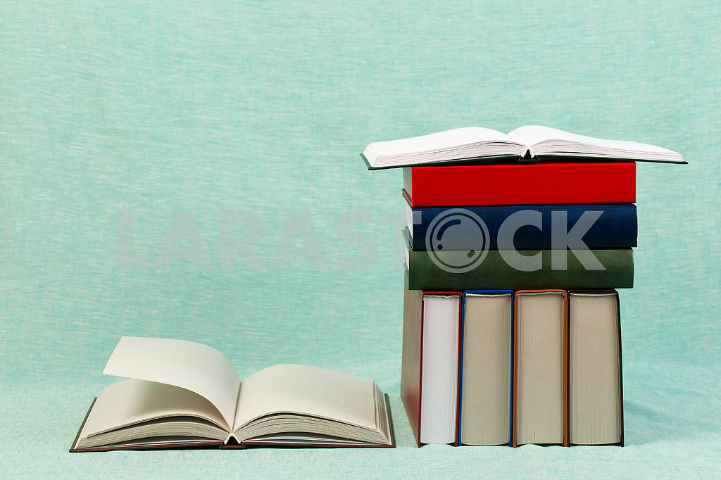 Stack of hardback books on wooden table. Back to school. — Image 47170