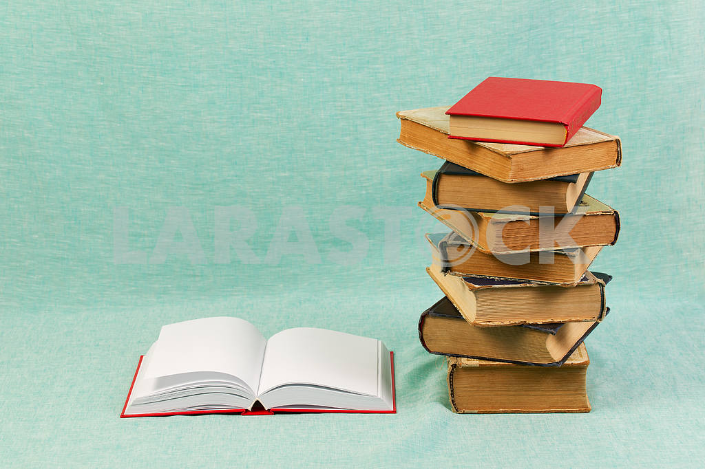 Stack of hardback books on wooden table. Back to school. — Image 47174