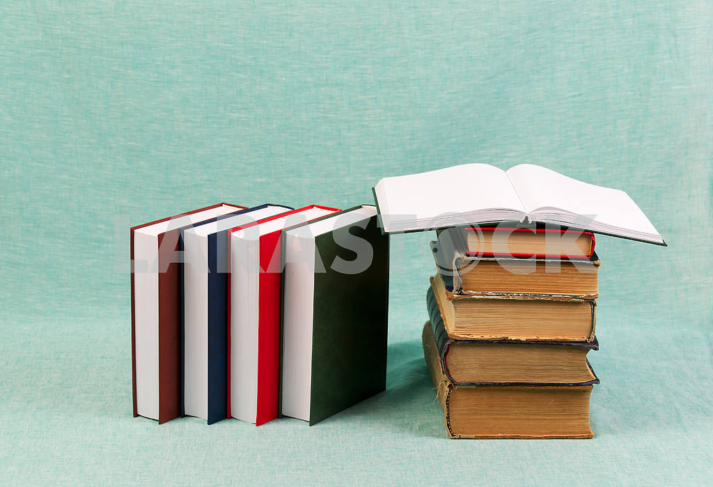 Stack of hardback books on wooden table. Back to school. — Image 47190