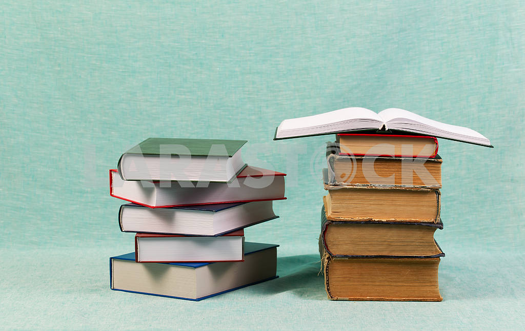 Stack of hardback books on wooden table. Back to school. — Image 47192