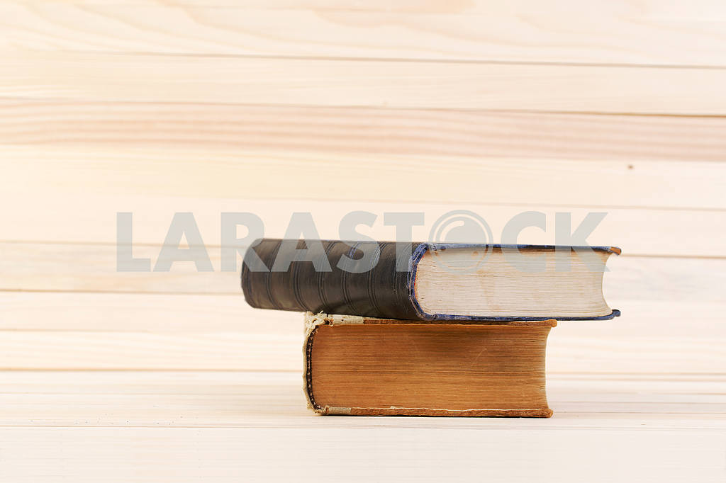 Stack of hardback books on wooden table. Back to school. — Image 47199