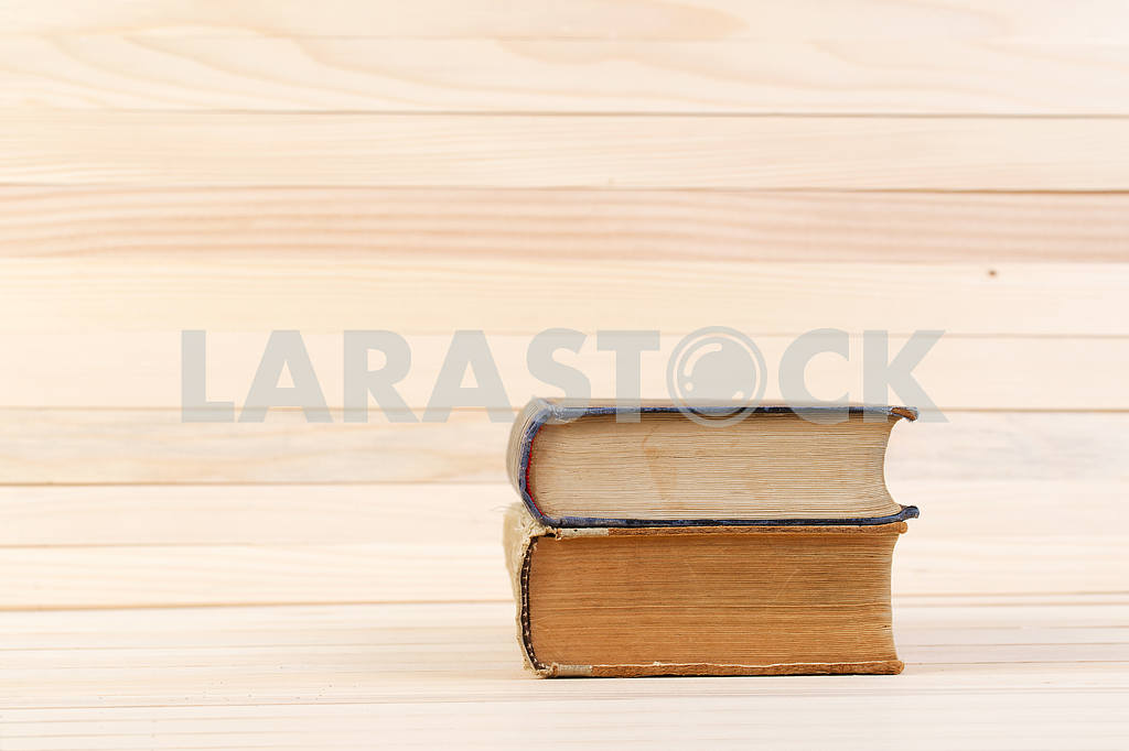Stack of hardback books on wooden table. Back to school. — Image 47200