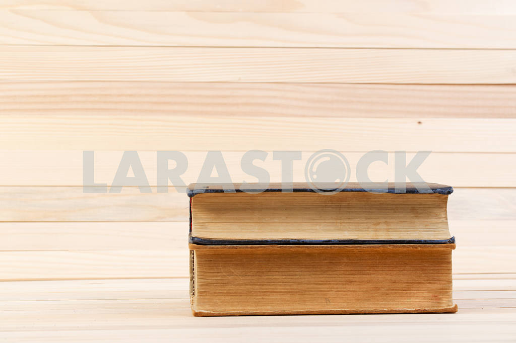 Stack of hardback books on wooden table. Back to school. — Image 47202