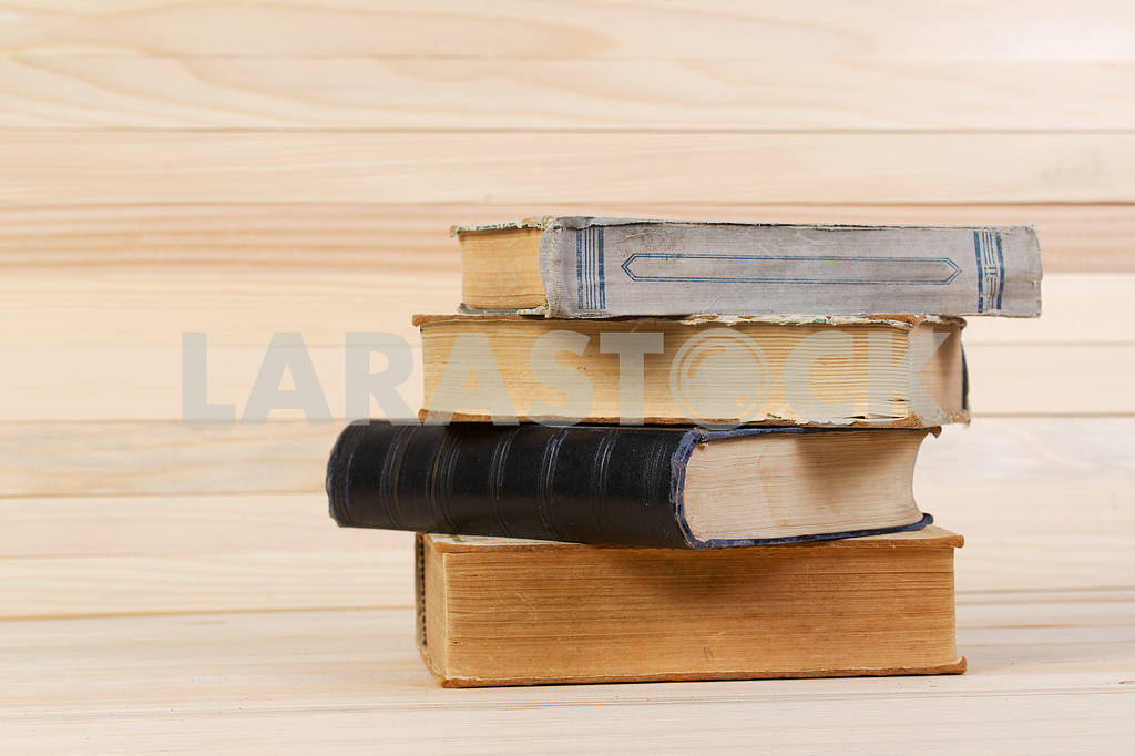 Stack of hardback books on wooden table. Back to school. — Image 47210