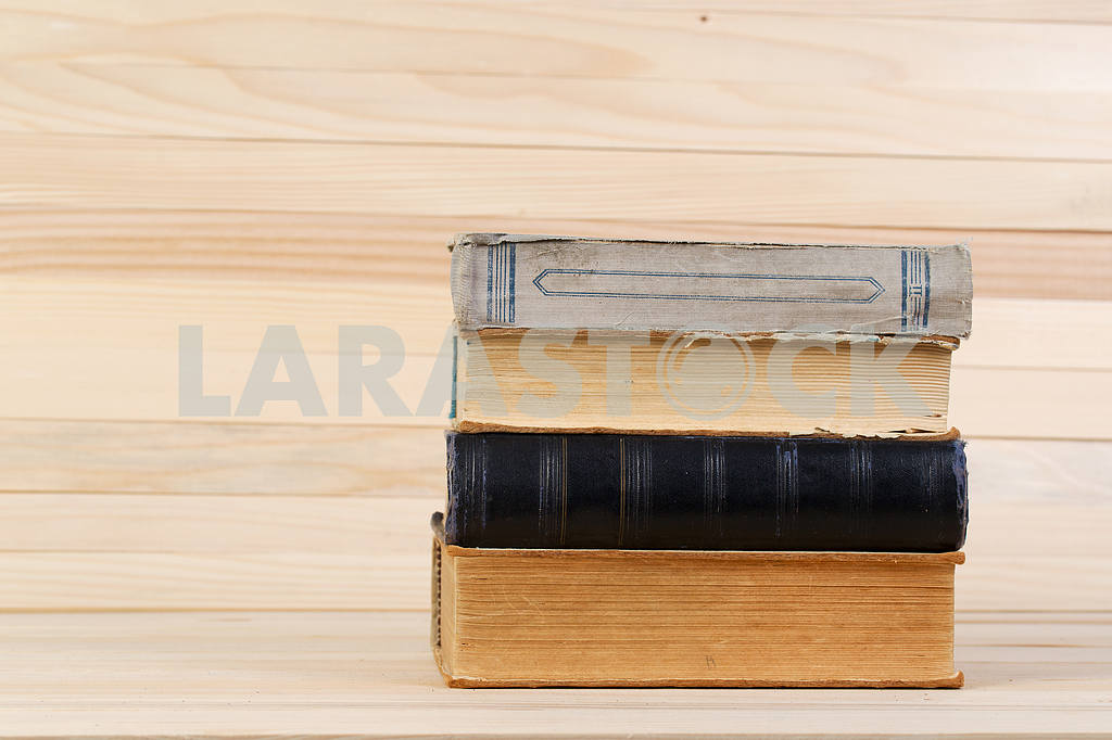 Stack of hardback books on wooden table. Back to school. — Image 47211