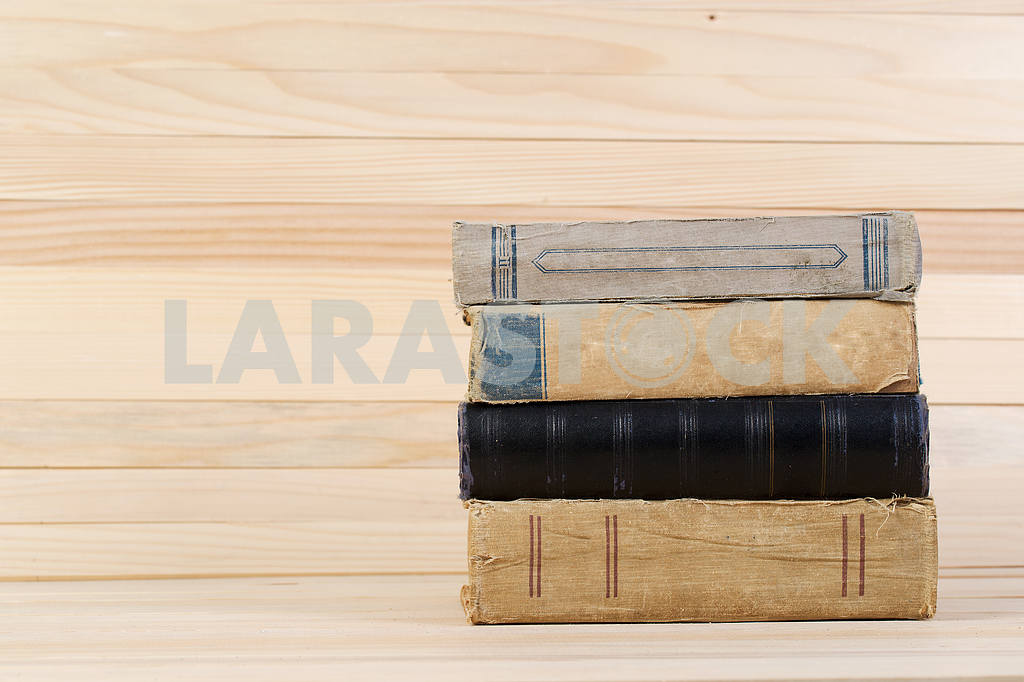 Stack of hardback books on wooden table. Back to school. — Image 47214