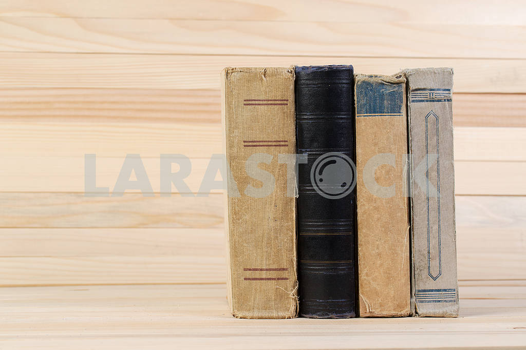 Stack of hardback books on wooden table. Back to school. — Image 47215