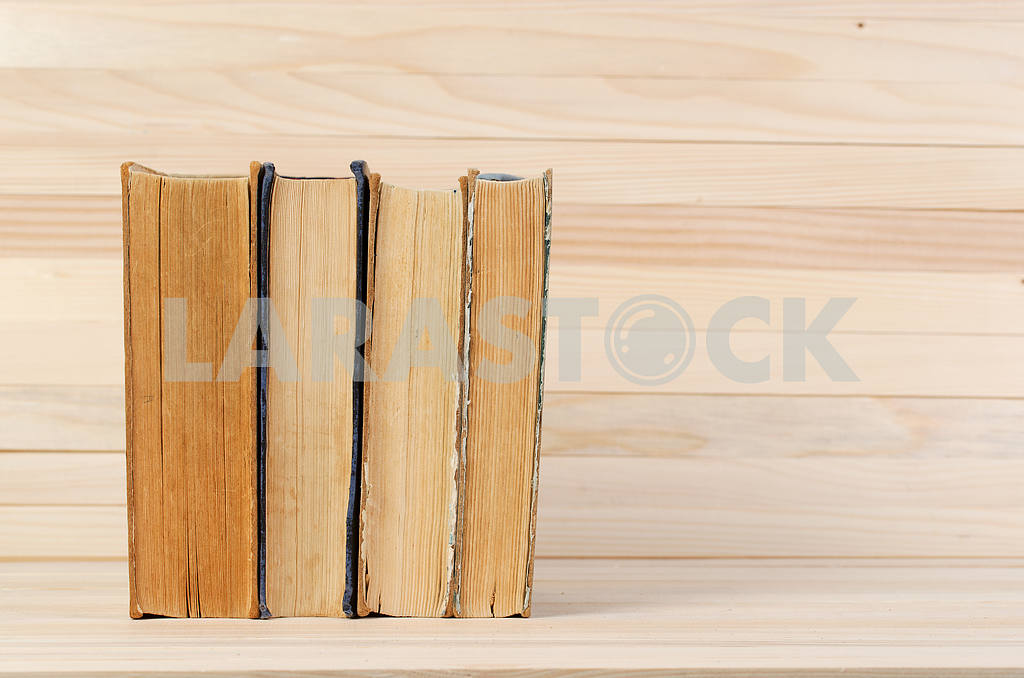 Stack of hardback books on wooden table. Back to school. — Image 47217