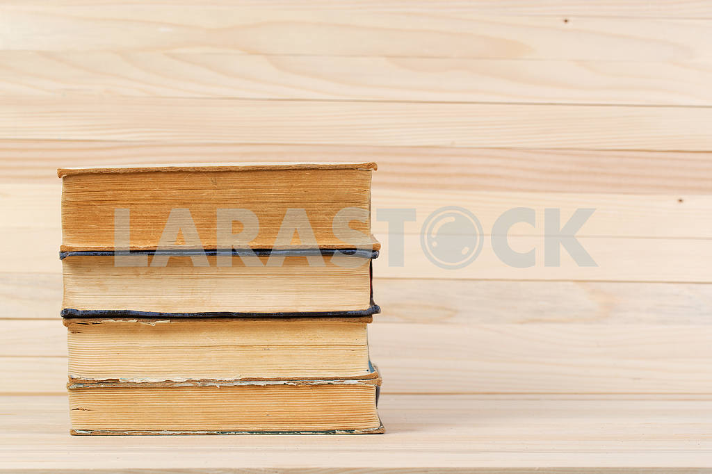 Stack of hardback books on wooden table. Back to school. — Image 47218
