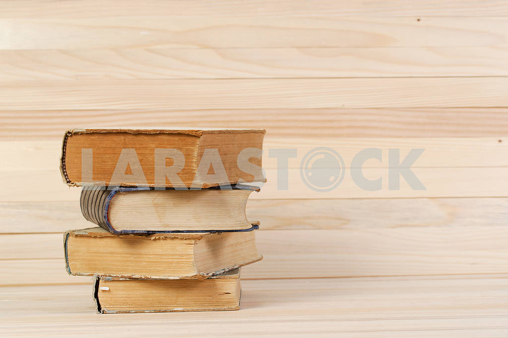 Stack of hardback books on wooden table. Back to school. — Image 47220