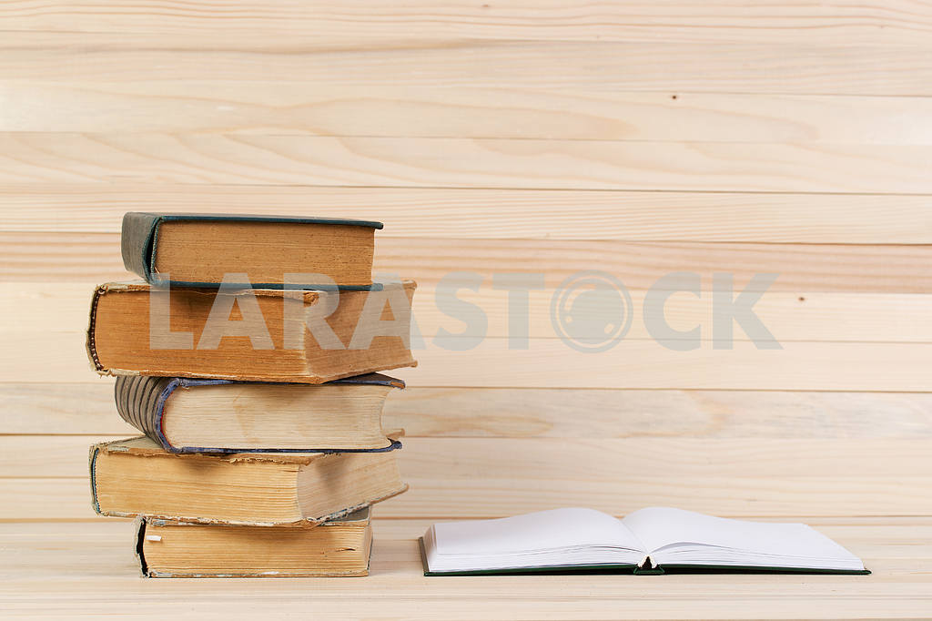 Stack of hardback books on wooden table. Back to school. — Image 47223