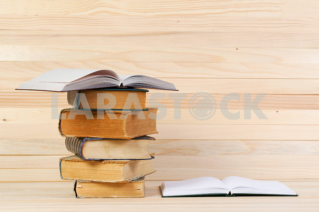 Stack of hardback books on wooden table. Back to school. — Image 47225