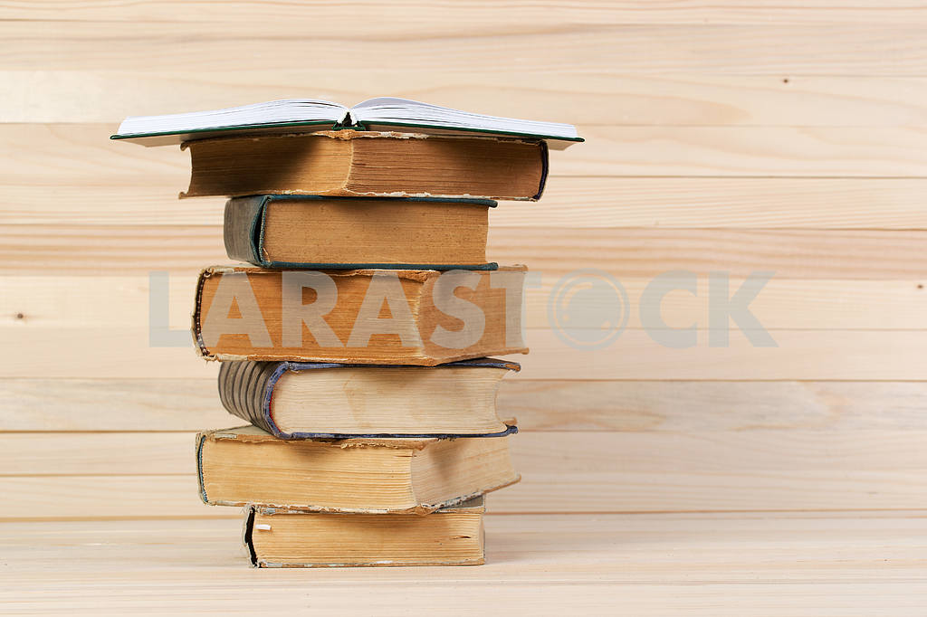 Stack of hardback books on wooden table. Back to school. — Image 47227