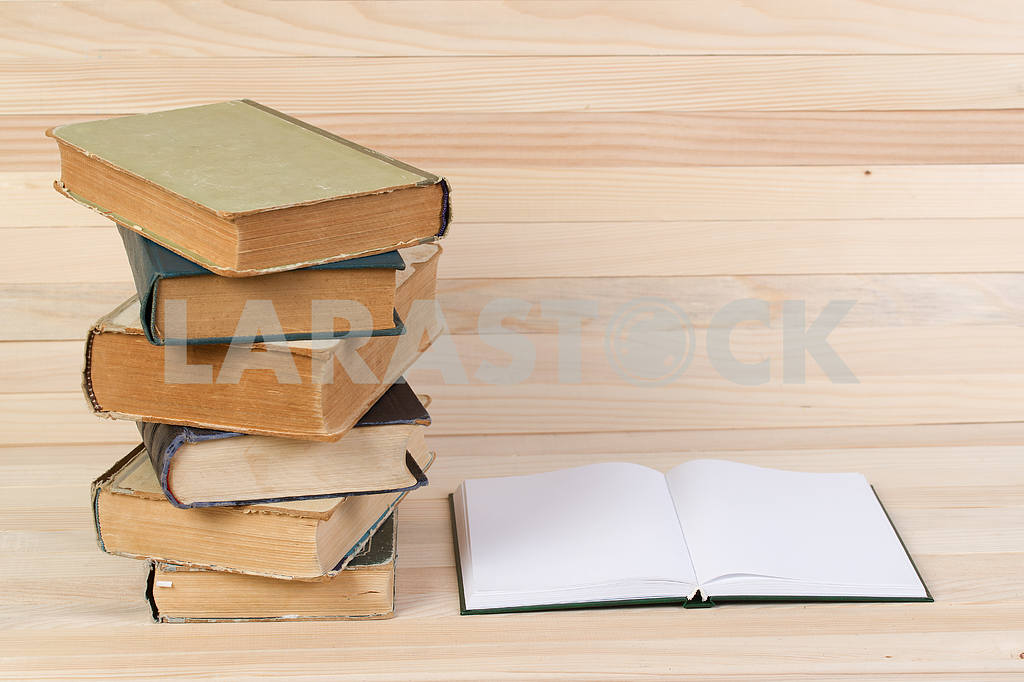 Stack of hardback books on wooden table. Back to school. — Image 47229