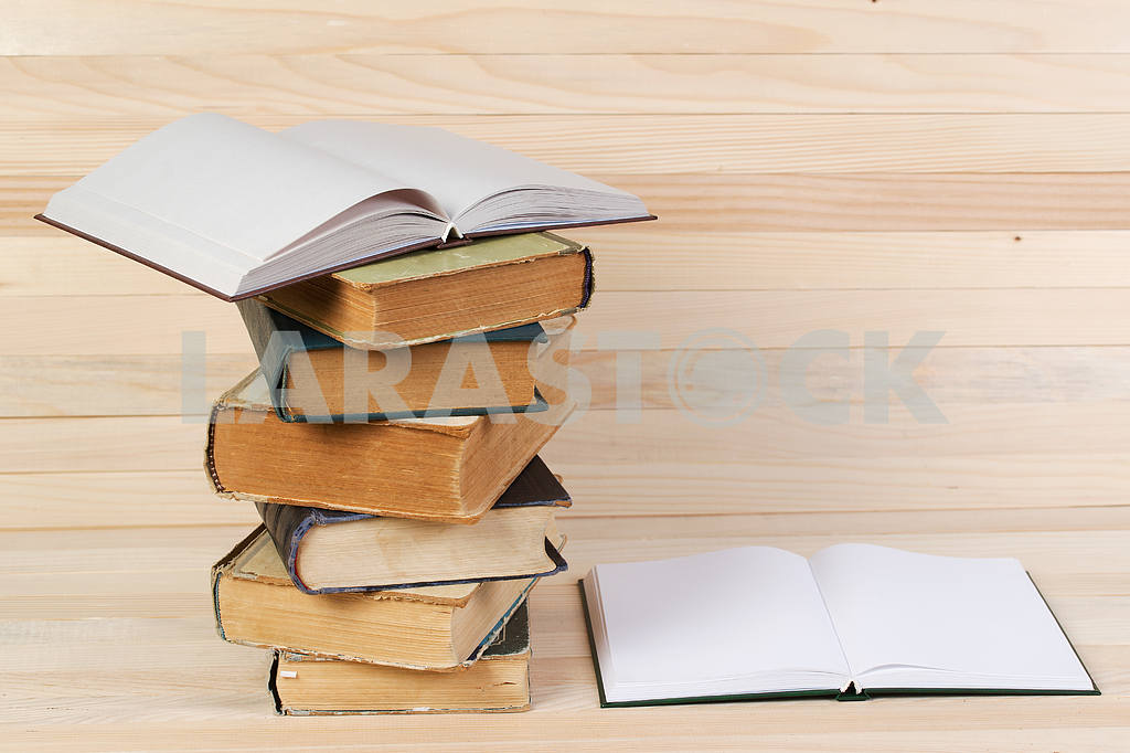 Stack of hardback books on wooden table. Back to school. — Image 47232