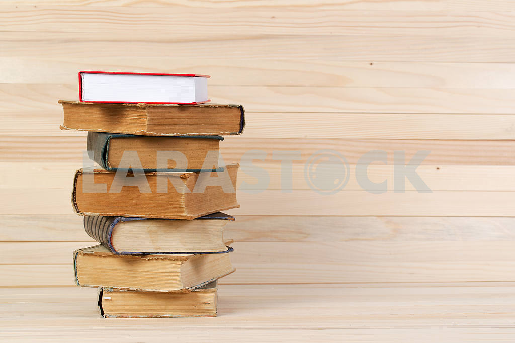 Stack of hardback books on wooden table. Back to school. — Image 47233
