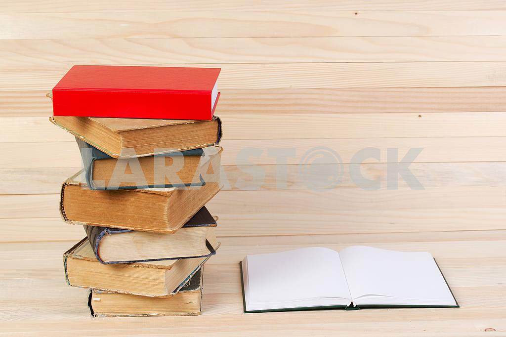 Stack of hardback books on wooden table. Back to school. — Image 47236