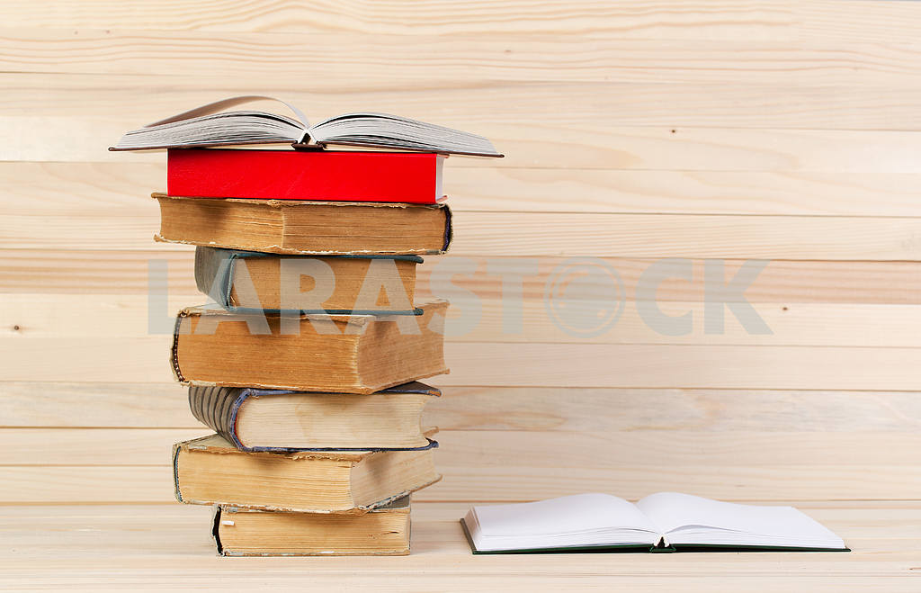 Stack of hardback books on wooden table. Back to school. — Image 47239