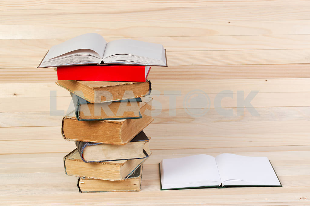 Stack of hardback books on wooden table. Back to school. — Image 47240