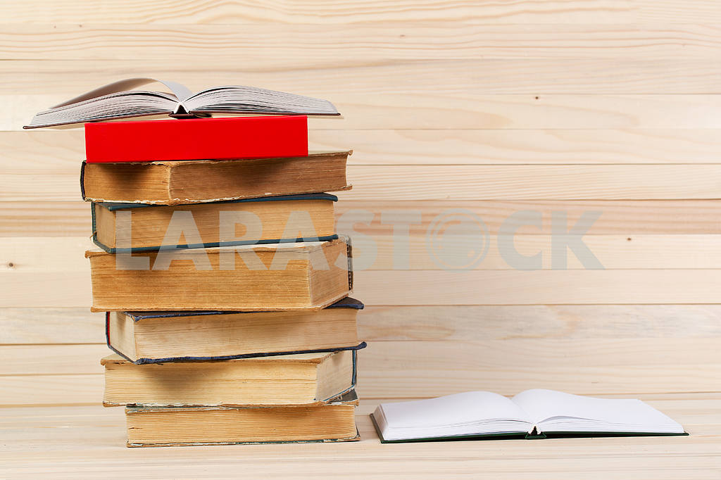 Stack of hardback books on wooden table. Back to school. — Image 47241