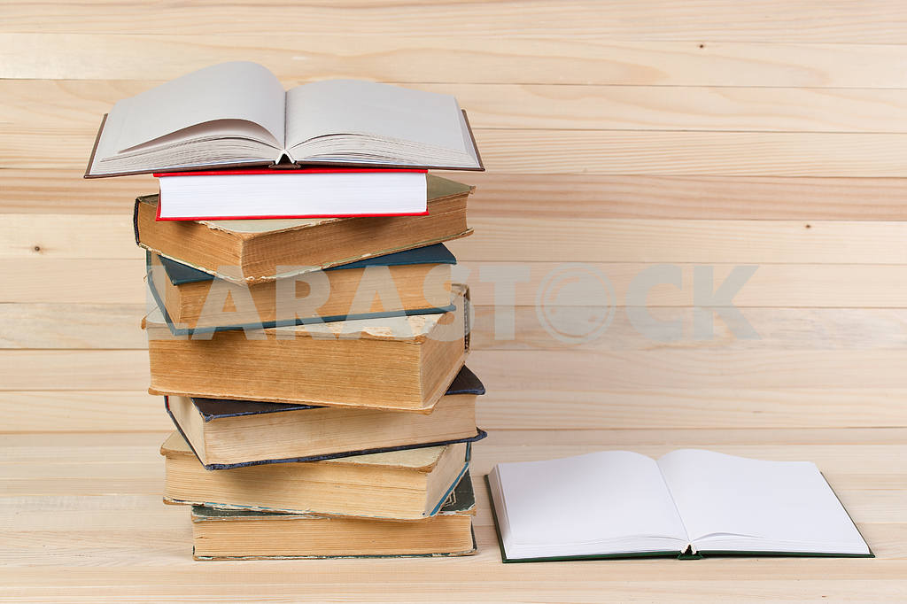 Stack of hardback books on wooden table. Back to school. — Image 47244