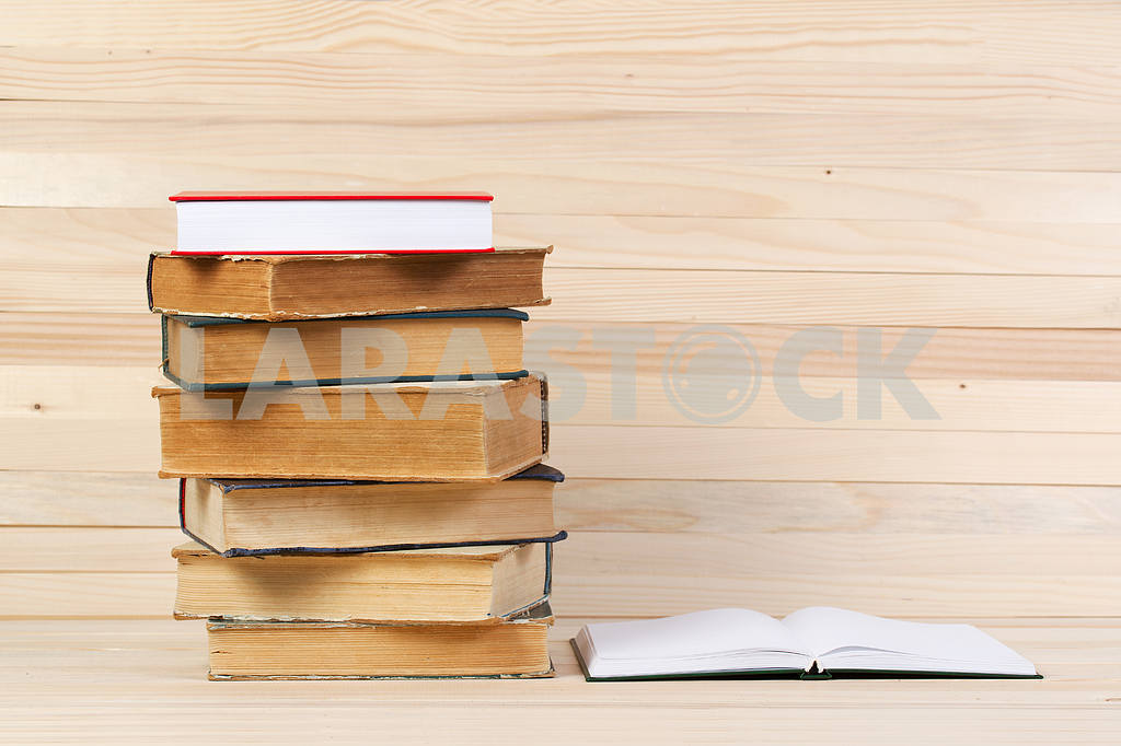 Stack of hardback books on wooden table. Back to school. — Image 47245