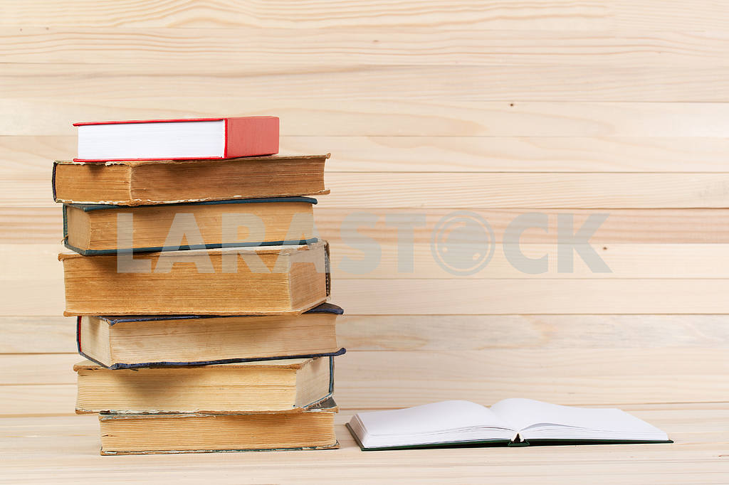 Stack of hardback books on wooden table. Back to school. — Image 47246