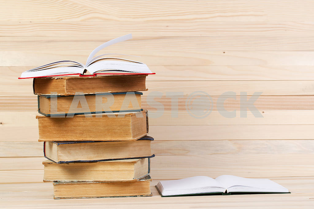 Stack of hardback books on wooden table. Back to school. — Image 47247