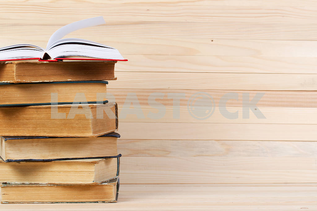 Stack of hardback books on wooden table. Back to school. — Image 47254