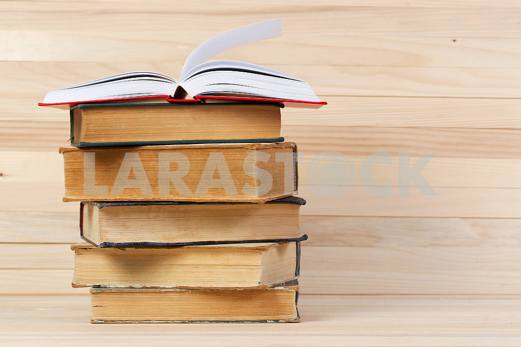 Stack of hardback books on wooden table. Back to school. — Image 47255