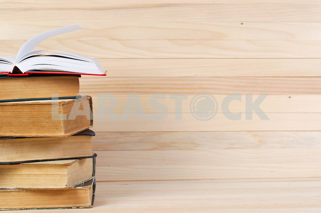 Stack of hardback books on wooden table. Back to school. — Image 47256
