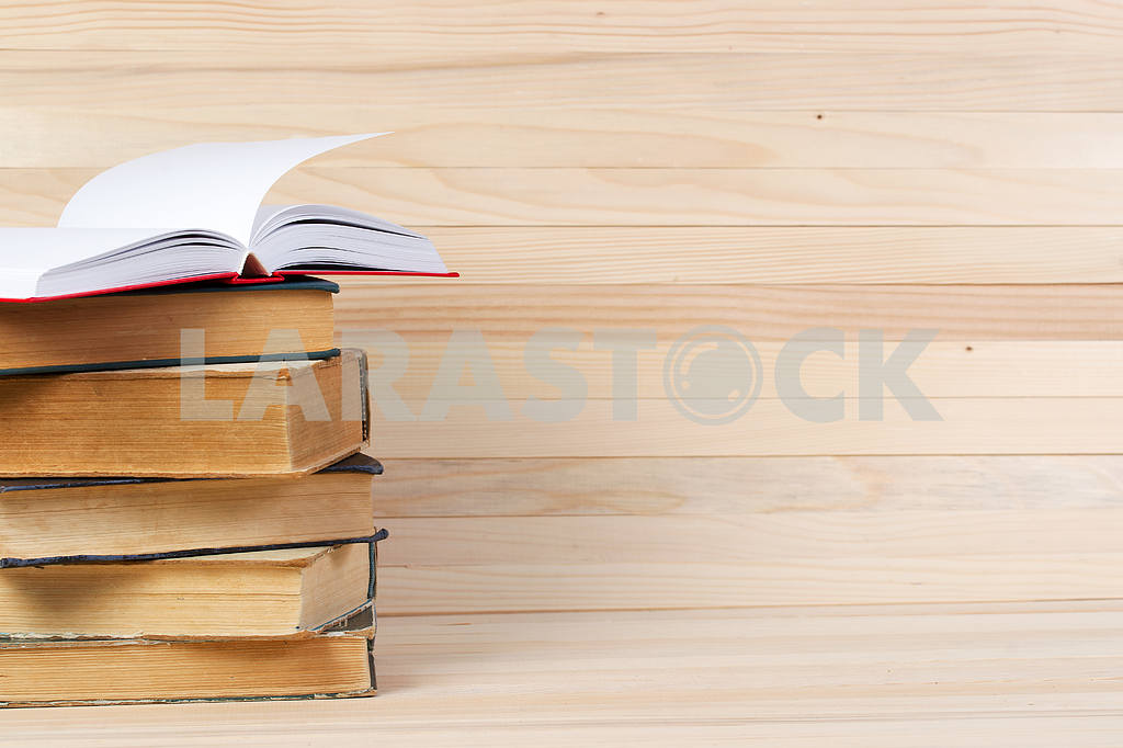 Stack of hardback books on wooden table. Back to school. — Image 47257