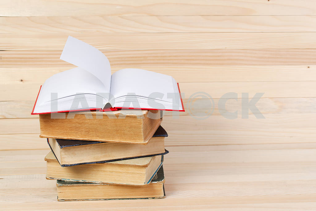 Stack of hardback books on wooden table. Back to school. — Image 47260